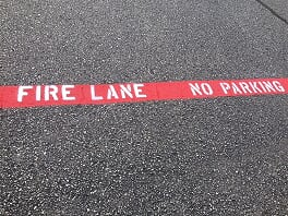 Fire lane stenciling on asphalt Baytown, Texas